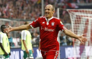Munich's new soccer player Arjen Robben celebrates during the German Bundesliga first division soccer match against VfL Wolfsburg in Munich