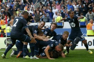 Tottenham Hotspur's players celebrate a goal by Paulinho during their English Premier League soccer match against Cardiff City in Cardiff