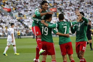 Mexico's players celebrate a goal by Peralta during their 2014 World Cup qualifying playoff second leg soccer match against New Zealand in Wellington