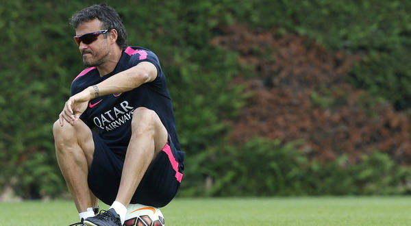 FC Barcelona's coach Enrique sits on the ball during a training session at the Ciutat Esportiva Joan Gamper in Sant Joan Despi